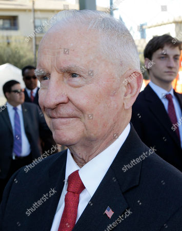 Ross Perot Ross Perot takes a question from a reporter during a ceremony at the construction site for the Perot Museum of Nature and Science, in Dallas. The billionaire former presidential candidate Perot and his family attended a ceremony to celebrate the placement of the final beam in the construction of the museum by the downtown area