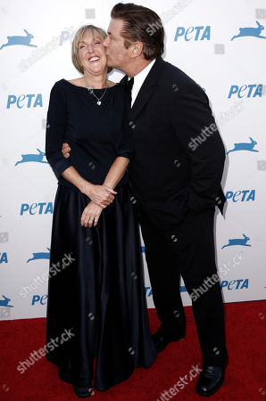 Alec Baldwin, Ingrid Newkirk Actor Alec Baldwin, right, kisses PETA president Ingrid Newkirk, at PETA's 30th Anniversary Gala and Humanitarian Awards in Los Angeles on