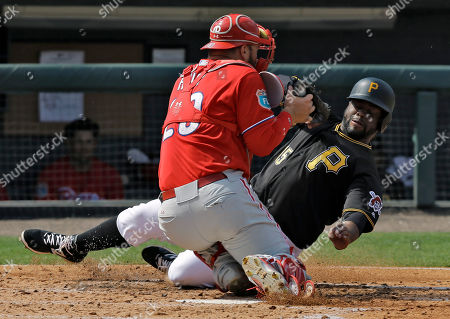 Jason Rogers, Cameron Rupp Philadelphia Phillies catcher Cameron Rupp hangs onto the ball after tagging out Pittsburgh Pirates' Jason Rogers, left, at home plate during the fifth inning of a spring training baseball game, in Tampa, Fla. Rogers tried to score on a hit by Alen Hanson