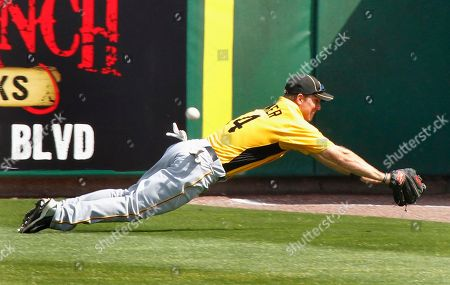 John Bowler Pittsburgh Pirates right fielder John Bowler dives but can't come up with a ball hit down by Philadelphia Phillies Ben Francisco during the fourth inning of a spring training baseball game in Clearwater, Fla., . Francisco ended up on second with a double