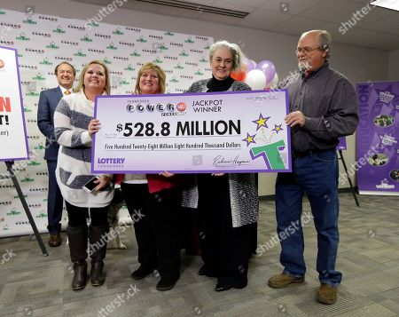 Rebecca Hargrove, John Robinson, Lisa Robinson, Tiffany Robinson, Joe Townsend Rebecca Hargrove, second from right, president and CEO of the Tennessee Lottery, presents a ceremonial check to John Robinson, right; his wife, Lisa, second from left; and their daughter, Tiffany, left; after the Robinson's winning Powerball ticket was authenticated at the Tennessee Lottery headquarters, in Nashville, Tenn. The ticket was one of three winning tickets in the $1.6 billion jackpot drawing. At far left is attorney Joe Townsend