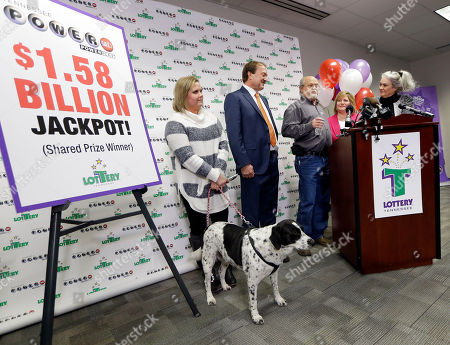 Rebecca Hargrove, John Robinson, Lisa Robinson, Joe Townsend, Tiffany Robinson Rebecca Hargrove, right, president and CEO of the Tennessee Lottery, announces that the winning Powerball ticket of the John and Lisa Robinson family is authentic, in Nashville, Tenn. From left are Tiffany Robinson, attorney Joe Townsend, John Robinson, Lisa Robinson, and Rebecca Hargrove. Tiffany holds the family dog, Abby. The Robinson's winning Powerball ticket is one of three winning tickets in the $1.6 billion jackpot drawing held Wednesday