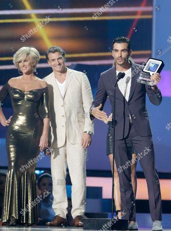 "Gonzalo Garcia Vivanco, Christian Bach, Juan Soler Gonzalo Garcia Vivanco speaks after receiving the Best Supporting Actor award from Christian Bach, left, and Juan Soler, center, during the Telemundo Spanish language television network's ""Premios Tu Mundo,"" (Your World Awards) show, in Miami"