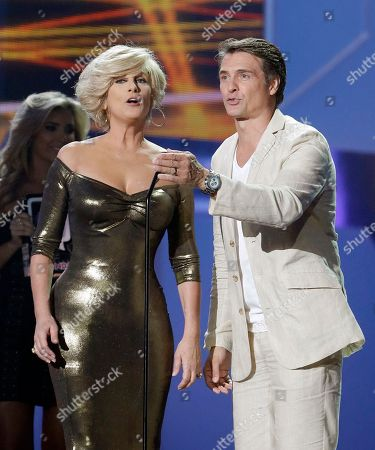 "Christian Bach, Juan Soler Presenters Christian Bach and Juan Soler are shown on stage during the Telemundo Spanish language television network's ""Premios Tu Mundo,"" (Your World Awards) show, in Miami"