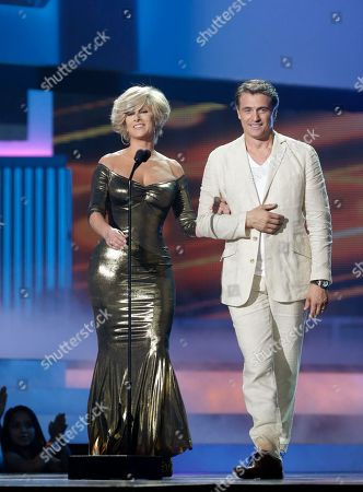 "Christian Bach, Juan Soler Presenters Christian Bach and Juan Soler take the stage during the Telemundo Spanish language television network's ""Premios Tu Mundo,"" (Your World Awards) show, in Miami"