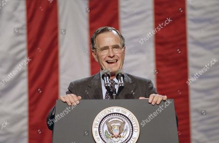 U.S. President George H. Bush reacts to screaming AIDS activists, who interrupted his speech to a Republican National Convention fundraising luncheon in Houston, .Bush replied to the protesters that his administration has sharply increased spending on AIDS research. Wednesday evening?s convention program includes a speech by Mary Fisher, who suffers from the disease