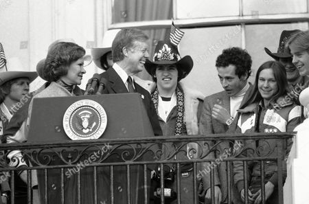 Jimmy Carter President Jimmy Carter beams as he stands with Mark Johnson, the sparkplug of the Gold Medal winning U.S. Olympic Hockey Team on the balcony of the White House in Washington on