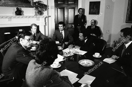 President Jimmy Carter, Kenneth Gibson, Stuart Eisenstat President Jimmy Carter meets with mayors from U.S. cities at the White House in Washington concerning the impact of cuts in the federal budget on . From left, around the table, are presidential assistant Stuart Eisenstat, President Carter, John Watson, and Kenneth Gibson, Mayor of Newark, N.J
