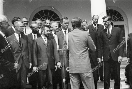 President John Kennedy shakes hands with members of the American expedition which topped Mt. Everest in 1963 as he walks along a line of the explorers at the White House Rose Garden . Present from left are, Dr. Melville Bill Grosvenor, president of the National Geographic Society; Allen C. Auten, Denver; R.M. Emerson, Cincinnati; dark hair hidden; Richard Pownall, Denver; Dr. Thomas Hornbein, San Diego; Barry Prather, Ellensburg, Wash.; Barry Bishop, Washington; James Whittaker, Redmond, Wash., party hidden Sherpa; Luther G. Jerstad, Eugene, Ore.; hidden Sherpa; Barry Corbet, Jackson, Wyo; David L. Dingman, Balitmore; Maynard M. Miller