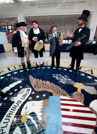 From left to right, Presidential presenter's Gary Beard, as George Washington, Dale Reynolds, as Thomas Jefferson, Peter Small as Teddy Roosevelt and Robert Broski as Abraham Lincoln, prepare to greet visitors at the The Richard Nixon Presidential Library and Museum on in Yorba Linda, Calif