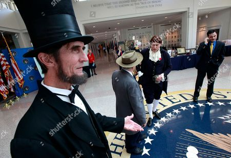 Presidential presenter Robert Broski as Abraham Lincoln, left, greets visitors on President's Day at The Richard Nixon Presidential Library and Museum on in Yorba Linda, Calif
