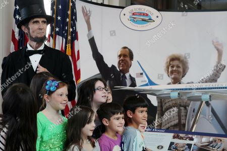 Robert Broski as Abraham Lincoln is photographed with children during a visit on President's Day at The Richard Nixon Presidential Library and Museum on in Yorba Linda, Calif