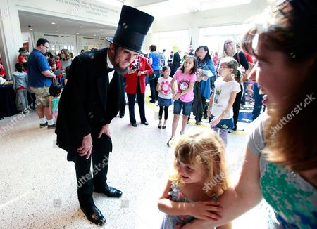 Presidential presenter Robert Broski as Abraham Lincoln greets visitors during the President's Day celebration at The Richard Nixon Presidential Library and Museum on in Yorba Linda, Calif