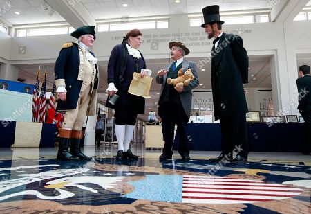 Presidential presenter's Gary Beard, as George Washington, Dale Reynolds, as Thomas Jefferson, Peter Small, as Teddy Roosevelt and Robert Broski, as Abraham Lincoln, prepare to greet visitors at the The Richard Nixon Presidential Library and Museum on in Yorba Linda, Calif