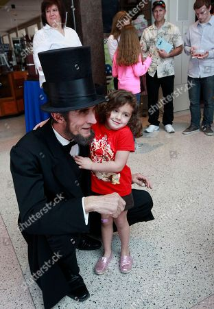 Robert Broski, as Abraham Lincoln, is photographed with Chloe O'Brien, 3, during the President's Day celebration at The Richard Nixon Presidential Library and Museum on in Yorba Linda, Calif