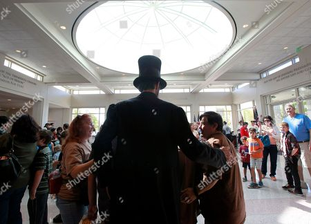 Presidential impersonator Robert Broski, as Abraham Lincoln, greets visitors President's Day at at the Nixon Presidential Library & Museum on in Yorba Linda, Calif. The event offered free cherry pie for the first 300 visitors and featured the four Mount Rushmore presidents