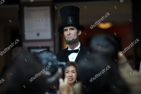 Robert Broski, as Abraham Lincolns is photographed with visitors during the President's Day celebration at The Richard Nixon Presidential Library and Museum on in Yorba Linda, Calif