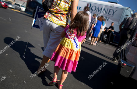 Alyta Mejia leads her daughter, Viky Kivisels, 4, back to their car after listening to comedian Paul Rodriguez speak at a rally for Mitt Romney, in Las Vegas. Romney officials argue that Hispanics, who suffer from a 9.9 percent unemployment rate, more than 2 points higher than the national rate, are naturally drawn to the GOP ticket. But some Romney supporters are pessimistic that Republicans can make inroads with a population that, many polls show, favors Obama by a 2-1 margin