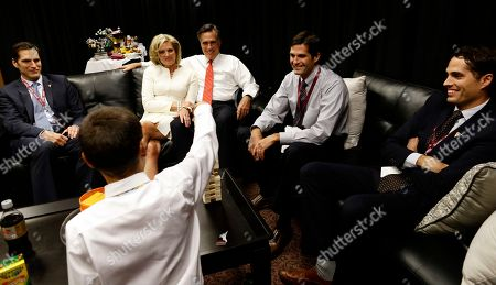 Mitt Romney, Ann Romney, Nick Romney, Craig Romney, Josh Romney, Matt Romney Republican presidential candidate former Massachusetts Gov. Mitt Romney is seated with his wife Ann Romney, second left, son Josh, left, son Matt, second right, and son Craig, far right, as grandson Nick pulls out a block as they play a game of Jenga in the family holding room before the start of the first presidential debate in Denver