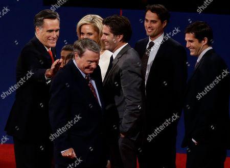 Jim Lehrer, Barack Obama Republican presidential candidate and former Massachusetts Gov. Mitt Romney pats moderator Jim Lehrer on the back at the end of the first presidential debate with President Barack Obama in Denver, . Also pictured, right to left: Matt romney, Craig Romney, Tagg Romney, Ann Romney