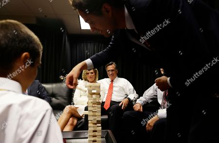 Mitt Romney, Ann Romney, Nick Romney, Craig Romney Republican presidential candidate former Massachusetts Gov. Mitt Romney is seated with his wife Ann Romney as his son Craig and grandson Nick as they play a game of Jenga in the family holding room before the start of the first presidential debate in Denver