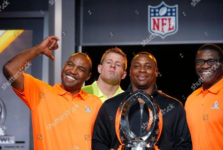 J.J. Watt, Michael Irvin, Troy Vincent, Darren Woodson As Troy Vincent, second from right, NFL Executive Vice President of Football Operations, holds the Pro Bowl Trophy, and Michael Irvin, right, NFL Hall of Fame player and Pro Bowl Alumni team captain, the group poses for photographers, Darren Woodson, left, NFL Hall of Fame player and Pro Bowl Alumni co-captain, smiles as he points to Houston Texans Pro Bowl Player J.J. Watt, second from left, who jokingly jumps into the group picture during the Pro Bowl Kickoff news conference, in Phoenix