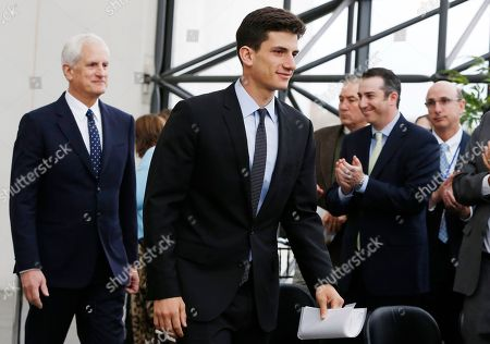 Jack Schlossberg, Edwin Schlossberg Jack Schlossberg, center, arrives for the John F. Kennedy Profile in Courage Award ceremony, followed by his father Edwin Schlossberg, left, at the John F. Kennedy Presidential Library in Boston, . Schlossberg presented the award to Connecticut Gov. Dannel P. Malloy for his vocal support of refugee resettlement