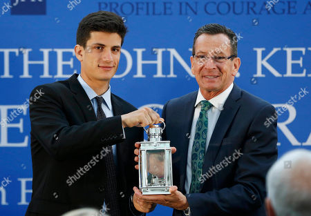Jack Schlossberg, Dannel P. Malloy Jack Schlossberg, left, and Connecticut Gov. Dannel P. Malloy pose with the John F. Kennedy Profile in Courage Award at the John F. Kennedy Presidential Library in Boston, . Schlossberg, presented Malloy, a Democrat, with this year's award for his vocal support of refugee resettlement