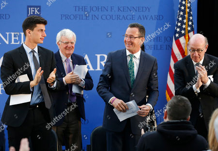 Dannel P. Malloy, Jack Schlossberg, Albert Hunt, Kenneth R. Feinberg Connecticut Gov. Dannel P. Malloy, center, acknowledges applause from the audience and Jack Schlossberg, left, Albert Hunt, second from left, and Kenneth Feinberg, right, after receiving the John F. Kennedy Profile in Courage Award at the John F. Kennedy Presidential Library in Boston