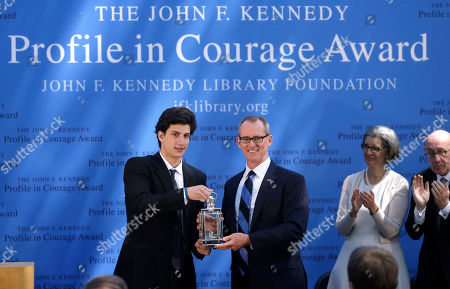 Jack Schlossberg, Bob Inglis Jack Schlossberg, left, grandson of former President John F. Kennedy, presents former U.S Rep. Bob Inglis, R-S.C., center right, with the 2015 Profile in Courage Award, at the John F. Kennedy Library and Museum, in Boston. Inglis was awarded the prize for reversing his position on climate change. Heather Campion, second from right, and Ken Feinberg, right, both of the JFK Library Foundation, look on