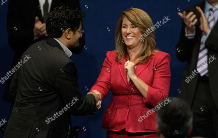Elizabeth Redfenbaugh, Wael Ghonim Recipients of the John F. Kennedy Profiles in Courage Award, Elizabeth Redfenbaugh, right, and Egyptian Wael Ghonim, left, shake hands at the conclusion during the ceremony at the JFK Library & Museum in Boston, Monday morning, . Ghonim's Facebook page played a role in organizing the protests that led to the ouster this year of former Egyptian President Hosni Mubarak. Redenbaugh, elected to the New Hanover County, N.C. school board in 2008, stood in opposition to a redistricting plan she feared would lead to racial segregation of middle schools
