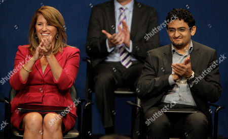 Recipients of the John F. Kennedy Profiles in Courage Award, Elizabeth Redfenbaugh, left and Egyptian Wael Ghonim, right, applaud during the ceremony at the JFK Library & Museum in Boston, Monday morning, . Ghonim's Facebook page played a role in organizing the protests that led to the ouster this year of former Egyptian President Hosni Mubarak. Redenbaugh, elected to the New Hanover County, N.C. school board in 2008, stood in opposition to a redistricting plan she feared would lead to racial segregation of middle schools
