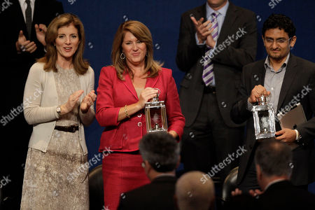 Caroline Kennedy, left, applauds recipients of the John F. Kennedy Profiles in Courage Award, Elizabeth Redfenbaugh, center and Egyptian Wael Ghonim, right, at the JFK Library & Museum in Boston, Monday morning, . Ghonim's Facebook page played a role in organizing the protests that led to the ouster this year of former Egyptian President Hosni Mubarak. Redenbaugh, elected to the New Hanover County, N.C. school board in 2008, stood in opposition to a redistricting plan she feared would lead to racial segregation of middle schools