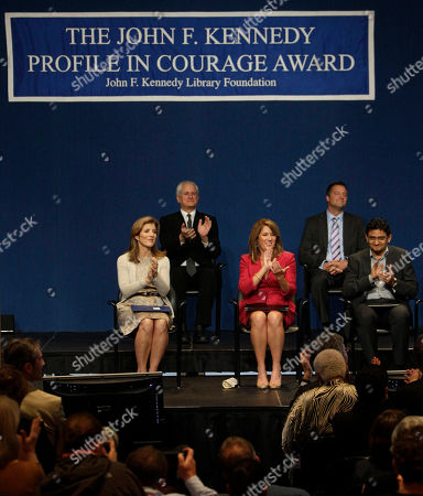 Caroline Kennedy, left, applauds recipients of the John F. Kennedy Profiles in Courage Award, Elizabeth Redfenbaugh, center and Egyptian Wael Ghonim, right, at the JFK Library & Museum in Boston, Monday morning