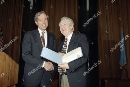 """Author Frank McCourt, right, receives the Pulitzer Prize for biography from Columbia University President George Rupp during the awards luncheon for the 1996 Pulitzer Prize winners, . McCourt won the award for """"Angela's Ashes,"""" his account of an impoverished childhood in Ireland"""