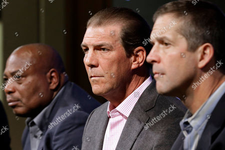 John Harbaugh, Ozzie Newsome, Steve Bisciotti Baltimore Ravens owner Steve Bisciotti, center, listens to a reporter's question as he sits between general manager and executive vice president Ozzie Newsome, left, and head coach John Harbaugh at an NFL football news conference, in Owings Mills, Md. The team held the news conference to review the 2014 season and discuss the upcoming season