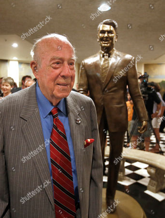 George Shultz Former Secretary of State George Shultz poses by a statue of his former boss, President Ronald Reagan, that was unveiled at the Capitol in Sacramento, Calif., . The 8-foot-tall bronze statue of California's 33rd governor and the 40th President of the United States was created by sculptor Douglas Van Howd and is on display in the basement the state Capitol rotunda