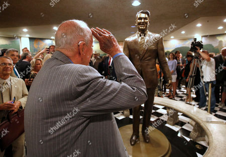 Geroge Shultz Former Secretary of State George Shultz salutes a statue of his former boss, President Ronald Reagan, that was unveiled at the Capitol in Sacramento, Calif., . The 8-foot-tall bronze statue of California's 33rd governor and the 40th President of the United States was created by sculptor Douglas Van Howd and is on display in the basement the state Capitol rotunda