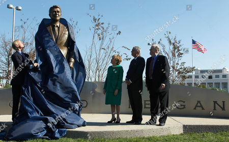 Ray LaHood, Elizabeth Dole, Charles Snelling, Frederick Ryan From left; Frederick Ryan, Jr., chairman of the Board of Trustees of the Ronald Reagan Presidential Foundation; former Transportation Secretary Elizabeth Dole; Transportation Secretary Ray LaHood and Charles Snelling, chairman of the Board of the Metropolitan Washington Airports Authority, take part in the unveiling of a statue of President Ronald Reagan, at Washington's Ronald Reagan National Airport. A nine-foot statue honoring Reagan has been unveiled at the Washington-area airport that bears his name, more than a decade after the facility was renamed for him