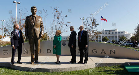 Ray LaHood, Elizabeth Dole, Charles Snelling, Frederick Ryan From left; Frederick Ryan Jr., chairman of the Board of Trustees of the Ronald Reagan Presidential Foundation, former Transportation Secretary Elizabeth Dole, Transportation Secretary Ray LaHood and Charles Snelling chairman of the Board of the Metropolitan Washington Airports Authority,unveil the statue of President Reagan, at Washington's Ronald Reagan National Airport. A nine-foot statue honoring former President Ronald Reagan has been unveiled at the Washington-area airport that bears his name, more than a decade after the facility was renamed for him