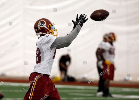 Reggie Bell Washington Redskins wide receiver Reggie Bell (18) catches the ball during NFL football practice, in Ashburn, Va