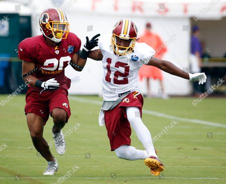 Andre Roberts, Richard Crawford Washington Redskins receiver Andre Roberts (12) plants his foot to try to avoid coverage by cornerback Richard Crawford during practice at the team's NFL football training facility, in Richmond, Va