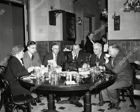 Edith Nourse Rogers, HOward Buffett, A.L. Miller, Karl Stefan, Hugh Butler, Carl Cortis Members of Congress listen to President Truman's radio announcement of complete Allied victory over Germany as they eat breakfast in the House office building restaurant . In group are left to right are: Rep. Edith Nourse Rogers (R-Mass); Rep. Howard H. Buffett (R-Nebr); Rep. A.L. Miller (R-Nebr); Rep. Karl Stefan (R-Nebr); Sen. Hugh Butler (R-Nebr); Rep. Carl T. Cortis (R-Nebr