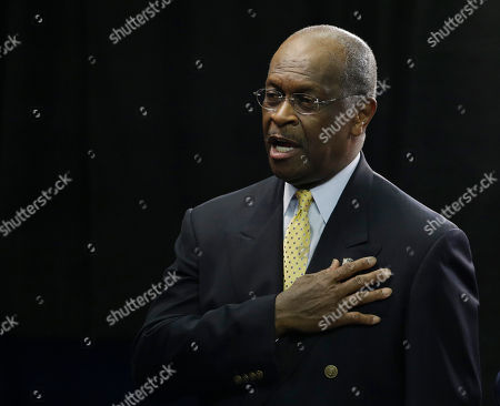 Herman Cain recites the Pledge of Allegiance during the Republican National Convention in Tampa, Fla., on