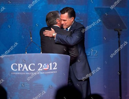 Mitt Romney, Al Cardenas Republican presidential candidate, former Massachusetts Gov. Mitt Romney embraces Al Cardenas, chairman of the American Conservative Union, at the Conservative Political Action Conference (CPAC) in Washington