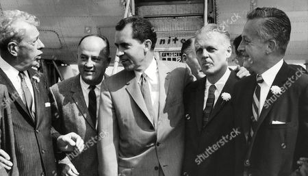 Stock Image of Richard Nixon Shown meeting Vice President Nixon as he arrived, in Decatur, Illinois. Left to Right are: U.S. Senator Everett Dirkson, H.G. Taylor, Nixon, Gov. William G. Stratton, and U.S. Senatorial Candidate Samuel Witwer. Nixon was to make a major farm speech in Sullivan, Illinois in afternoon