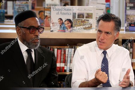 Mitt Romney, Kenneth Gamble Republican presidential candidate, former Massachusetts Gov. Mitt Romney, right, joined by the Universal Bluford Charter School founder Kenneth Gamble, gestures during a round table discussion at the school, in Philadelphia