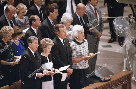 Nancy Reagan, Ronald Reagan, George H. W. Bush, Barbara Bush, George P. Shultz, Helena Maria Shultz, Edwin Meese, Ursula Meese, Maureen Reagan President Ronald Reagan, front left, and Mrs. Nancy Reagan participate in a memorial service held for Commerce Secretary Malcolm Baldrige, who died last week after an accident while rodeo riding, at the National Cathedral, Washington, D.C. Vice President George H. W. Bush and Mrs. Barbara Bush stand next to the Reagan, Secretary of State George P. Shultz and Mrs. Helena Maria Shultz are behind at right, Attorney General Edwin Meese and Mrs. Ursula Meese are behind, left, and Maureen Reagan stands behind her father