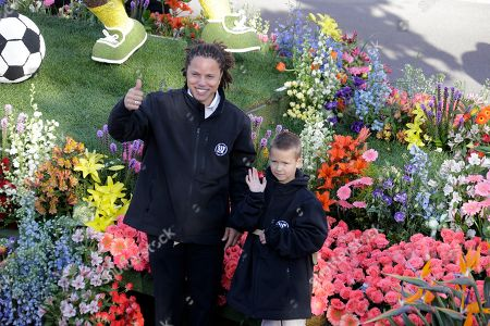Cobi Jones Cobi Jones, left, former USA and LA Galaxy soccer star, waves from the Torrance, Calif., Rose Float Association entry in the 125th Rose Parade in Pasadena, Calif