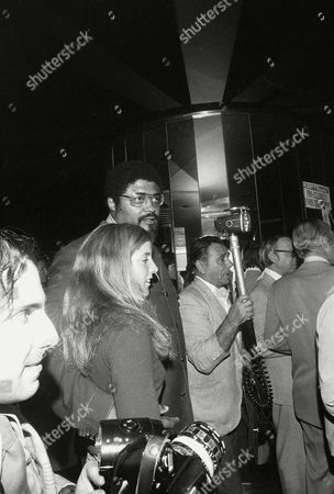 """Rosey Grier, Caroline Kennedy Former professional football player Roosevelt """"Rosey"""" Grier is with Caroline Kennedy, daughter of the late President John F. Kennedy, at a New York party held on the eve of the Robert F. Kennedy pro-celebrity tennis tournament at Forest Hills"""